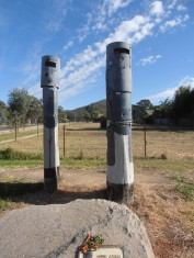 Totems depicting the soldiers at Ned Kelly siege